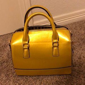 Gold/ yellow metallic handbag